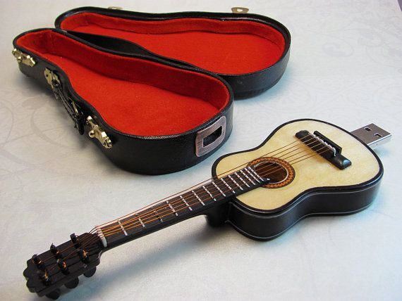 Guitar USB drive 8GB made from pine with great care and detail. Comes with this great lined carry along guitar case that latches shut. The guitar strings are copper wire and the tuning knobs even adjust the tension!