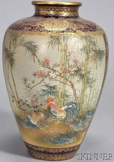 A Japanese Satsuma vase, reservesof roosters and ducks with flowering plants, cobalt ground with stylized phoenixes in gilt, signed Kinkozan, Japan, circa 1801-1900
