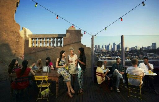 Rooftop bar in Fitzroy overlooking Melbourne in the background