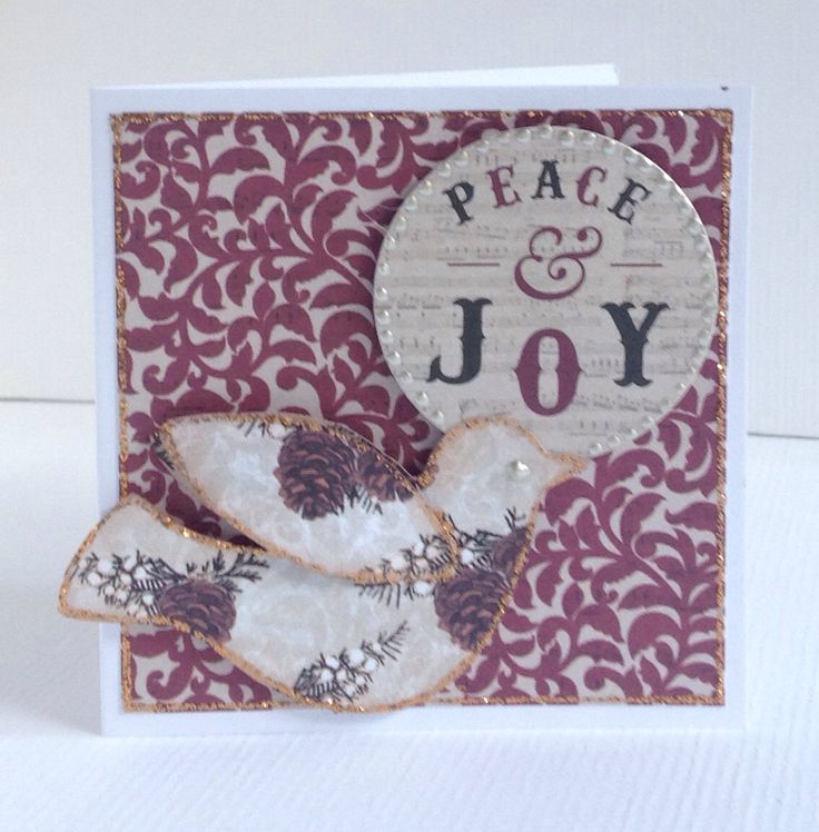 Card designed by Julie Hickey using Mistletoe 6x6 paper pad, die cuts and template. Gorgeous Christmas card in traditional colours with lovely sentiment and dove from template on to tiny card blank.