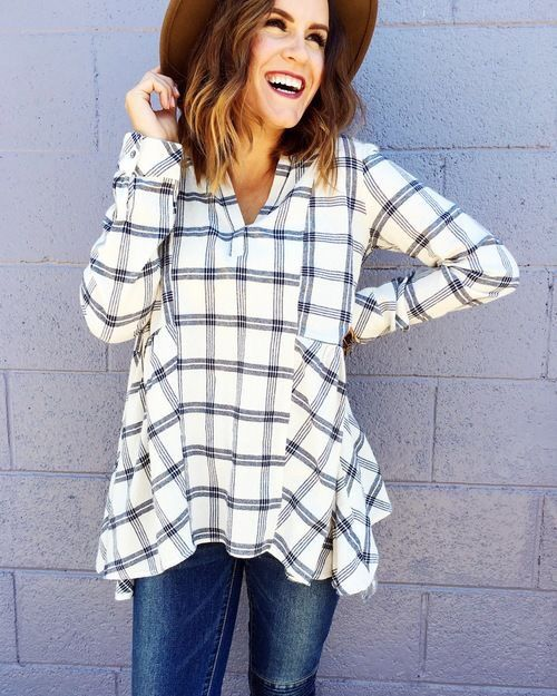 Cute spin on a flannel shirt.  Looks great for fall!