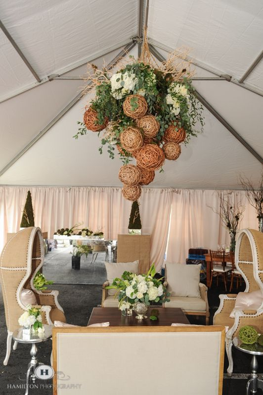 Amazing floral chandelier by www.intrigue-designs.com adds drama to this eco-chic wedding lounge completed with burlap domchairs and linen accent chairs with white washed wood and pewter tables. The mercury glass centerpiece with mirror cubes white hydrangea, ranunculous and a variety of grey toned greens created a warm stmosphere. The custom bar with burlap end caps finished the look with moss sculptures. Swooning over this suspended floral arrangement hanging. www.hamiltonphotography.net