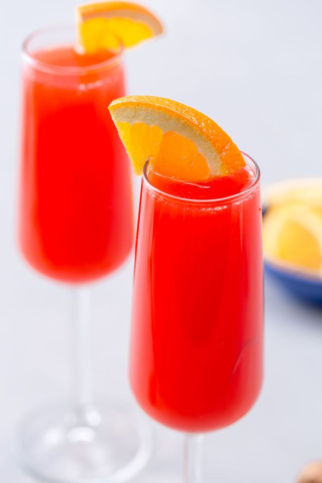 Cherry Bomb Mimosas I Made with pineapple juice, maraschino cherry juice and champagne I Delish.com