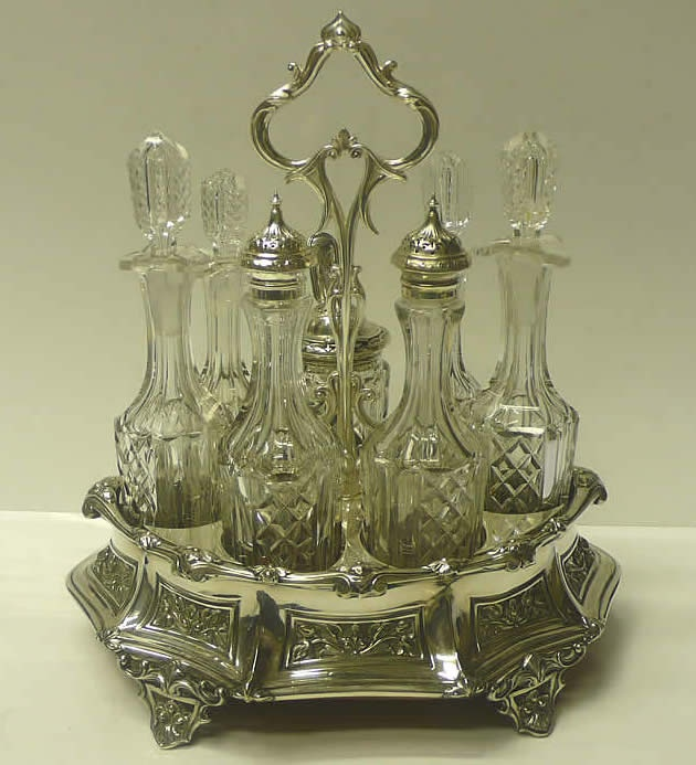 An Excellent Antique Silver Plated 7 Bottle Cruet Set With 4 Cut Crystal Oil And Vinegar Bottles