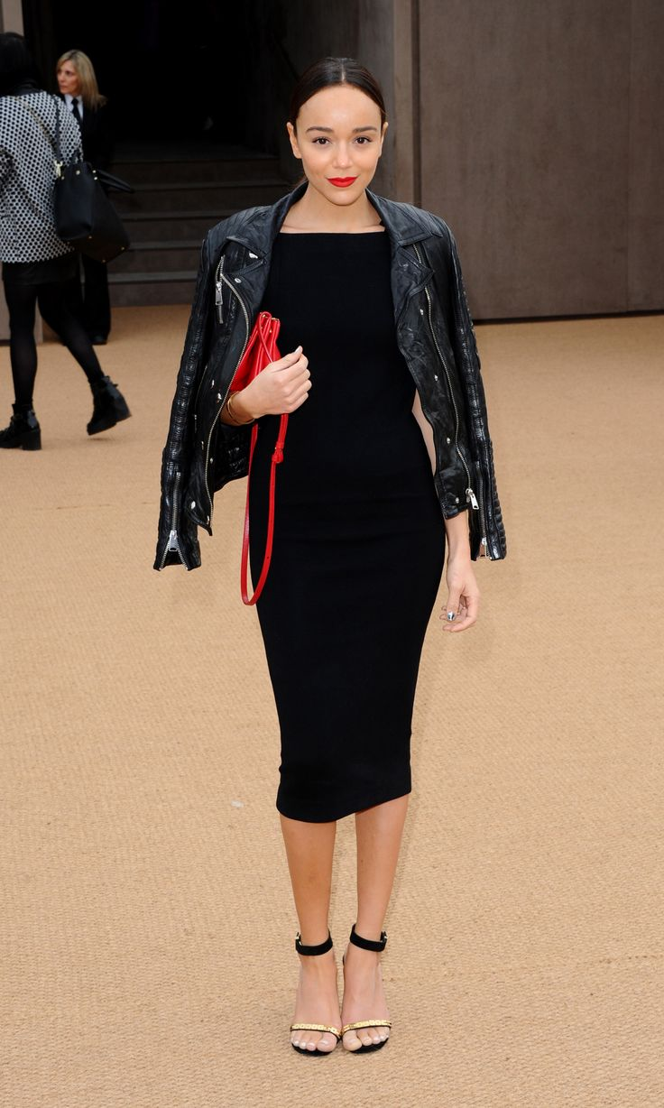 pencil-silhouette dress with a Burberry leather jacket, gold-trim sandals, and a shocking red purse (that matches her lipstick!). Her outfit is pretty much how we want to look at every date