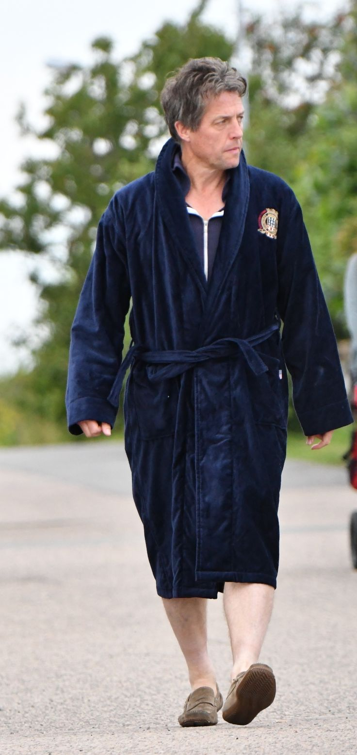 Actor Hugh Grant spotted on his way to the beach, wearing our cozy Lexington Velour Robe. Photo: Torsten Laursen/Expressen     www.lexingtoncompany.com/men/clothing/robes/lexington-velour-robe-blue