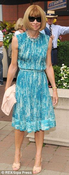 Anna Wintour.. August 2008.. Paired with a bright blue dress.. worn the same nude, pointy-toed slingbacks, since 1994, which are made-to-measure by, Manolo Blahnik himself!