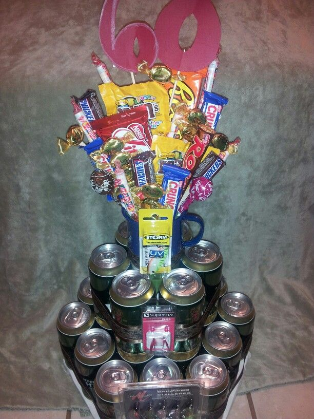 Fishing themed beer cake with candy bouquet topper. Custom order.   Facebook.com/MemorablySweetArrangementsandGifts