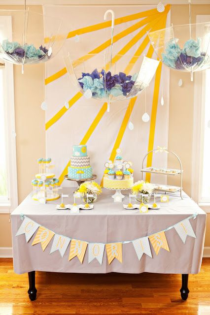 Sunshine Party: Table decorations. Sun beams on the wall behind and the clear umbrellas hung from the ceiling.