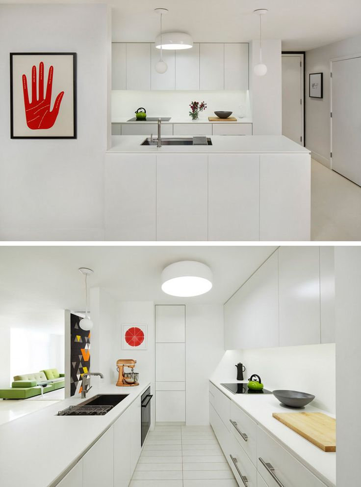 Kitchen Design Idea - White, Modern and Minimalist Cabinets | The white cabinetry in this kitchen is only broken up by the black appliances and small decorative elements like the green kettle and red art piece.