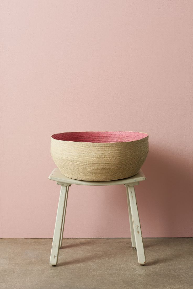 The Nido Basket in pink adds a pop of color to your décor!