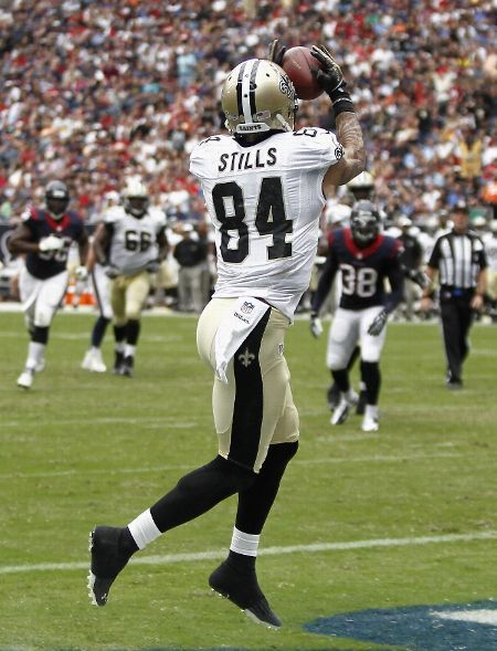 Kenny Stills #84 of the New Orleans Saints scores in the second quarter against the Houston Texans at Reliant Stadium on August 25, 2013 in Houston, Texas. (Photo by Bob Levey/Getty Images)