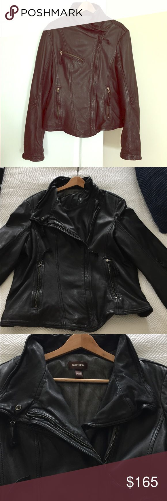 Danier Leather Moto jacket Heavy weight leather motorcycle jacket by Danier. Asymmetrical zip up and button closure, with zip pockets and leather pulls. Tab button and zip closure at wrists. Fitted body, hits at lower waist. Fully lined. Very warm and the leather is soft and flexible. Only wore a handful of times because the sleeves were a little too long for me. This jacket is very high quality, not cheap thin leather, it's nice and thick. Purchased in Whistler B.C. It's XL but feel it fits…