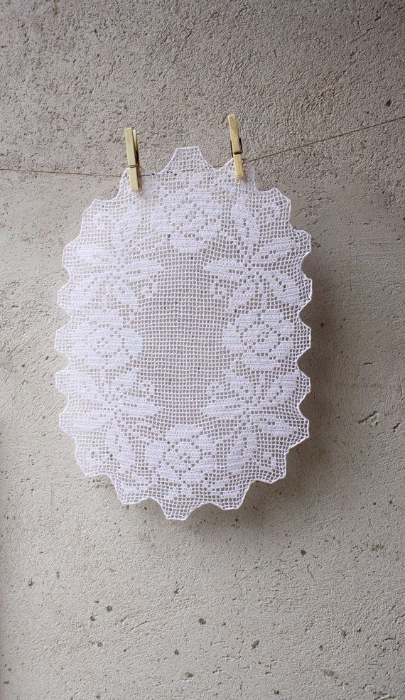 Oval white crochet doily with floral pattern for a romantic style ...