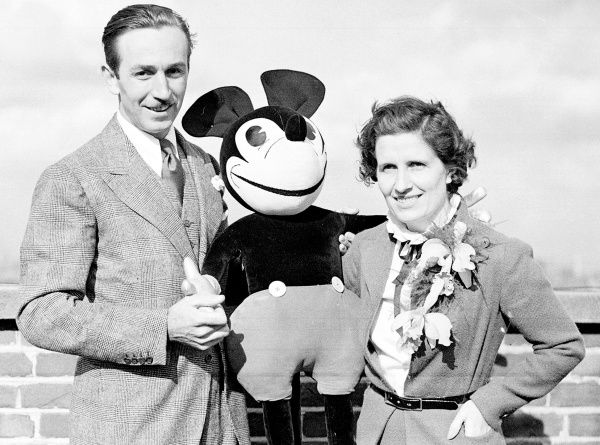 """<b>June 12, 1935 – Mickey Mouse Park</b><br> The idea of Disneyland percolated in Walt Disney's head for decades. He first thought of it in the 1930s, around the time this photo was taken with his wife, Lillian, on their 10th anniversary. As Walt began to take their daughters, Diane and Sharon, to Griffith Park to ride the carousel, he imagined a park that entertained entire families – children and adults. He first thought of calling it """"Mickey Mouse Park,"""" based on hi..."""