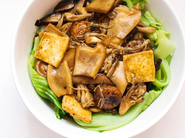 Every year, families celebrate the Chinese Lunar New Year with an impressive feast called Reunion Dinner, and among the many plates on the table is abalone in a rich sauce with dried oysters, shiitakes, and an algae called black moss. Inspired by that dish, this recipe is a vegetarian take with easier-to-find ingredients, like tofu and both fresh and dried mushrooms. Even without the seafood it still delivers on the richness and flavor of the original.