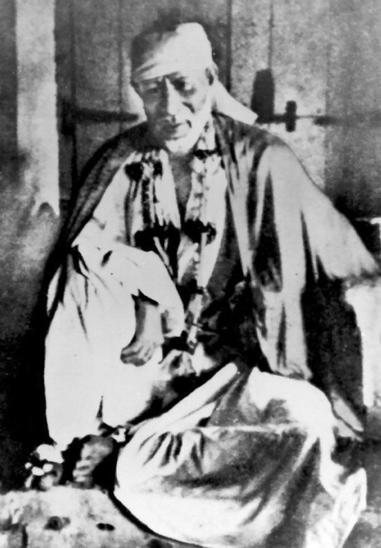 Original photo of Sai Baba of Shirdi, also known as Shirdi Sai Baba. He was an Indian spiritual master who is regarded by his devotees as a saint, a fakir, a satguru and an incarnation (avatar) of Lord Shiva. He is revered by both his Hindu and Muslim devotees during, as well as after his lifetime. According to accounts from his life, he preached the importance of realization of the self, and criticized love towards perishable things. His teachings concentrate on a moral code of love…