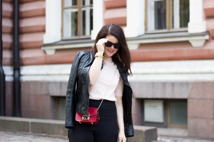 Pink knit, red bag, black culottes