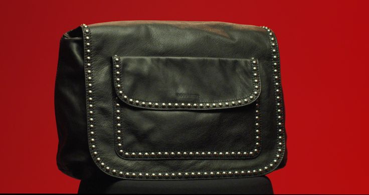 Unique leather designs are pierced with silver studded details for an unconventional punk aesthetic. Shop #D2Bags at Dsquared2.com