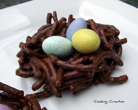 Easy Easter Dessert : ) Melt chocolate chips and peanut butter over pretzel sticks and add candy eggs.  I think I could do this one lol