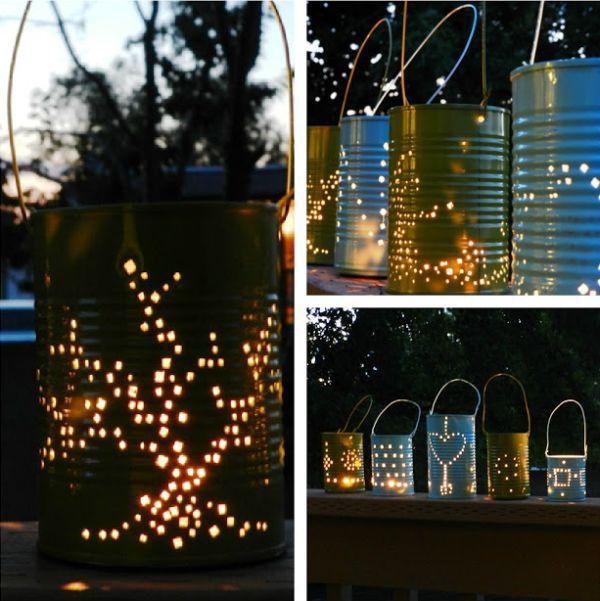 des lanternes DIY à base de boîtes de conserves avec des bougies