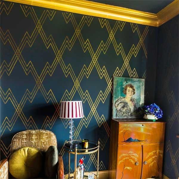 Farrow & Ball's Hague Blue and The Stencil Library's Bright Gold paint are stenciled in a deco motif that's ideal for a study or a dining room. | thisoldhouse.com