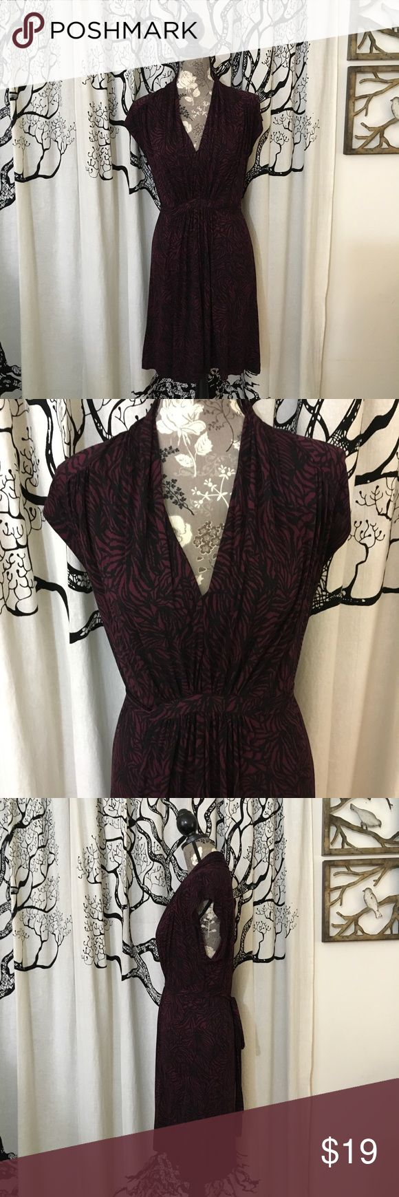 French Connection Soft Tie Back Dress Beautiful soft French Connection dress in oxblood and black. Gathered waist at the front with sash tie in the back. V-neck with flutter cap sleeves. Rayon/cotton/spandex. Perfect condition with no signs of wear (worn once). Measurements provided in photos. Looks great with a black cardigan or jacket, tights and boots! French Connection Dresses Midi