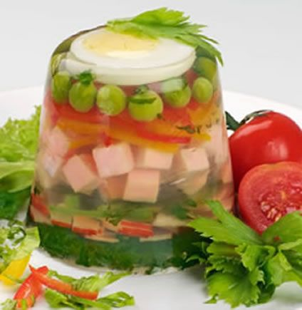 Aspic was first used to stop air from spoiling meat before the days of refrigeration. Today, aspic is used for flavoring and to make dishes, such as this gelatin pea and ham salad, highly decorative. Aspic is made with broth so you can use chicken aspic, tomato aspic, vegetable aspic or another flavor.