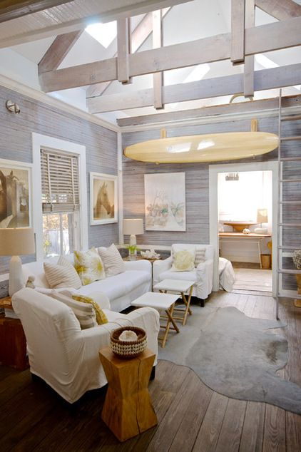 comfy beachy surfy (i would nix the horses on the walls tho ;) // beach style family room by Starr Sanford Design