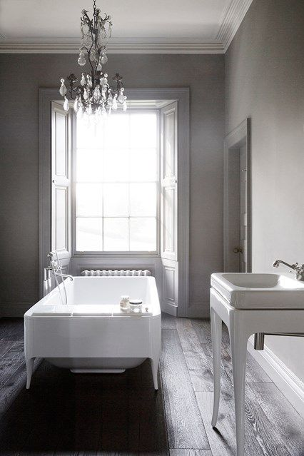 Grey & White Bathroom in Bathroom Inspiration on HOUSE - bathroom with a neutral scheme, elaborate glass chandelier and free standing bath in a carefully renovated country house in Somerset.