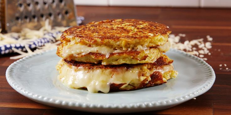 "Cauliflower Grilled Cheese. The ""bread"" is cauliflower mixed with cheese. SO up my alley. Also, I bet you could make this with my favorite veggie, romanesco!"