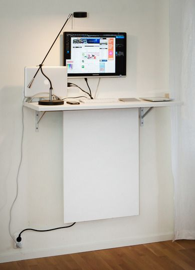 wall shelf as standing desk with cord hiding panel