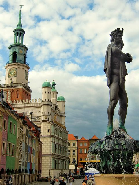Apollo Fountain and City Hall - Poznan   There are 4 fountains each on a corner of the Market Square: Proserpina, Apollo, Poseidon, and Mars. This is Apollo.