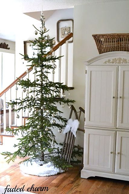 I love Charlie Brown trees..better to display gorgeous ornaments & to use spinners...love this! Merry rustic Christmas, a home tour at Faded Charm, featured on I Love That Junk