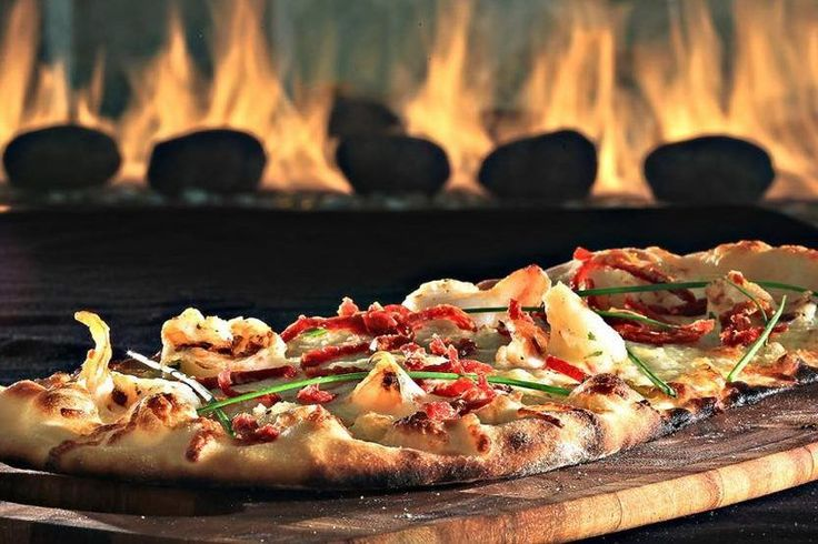 Hilton Opens Food Court to Public at Its Global Headquarters  A new food court with a wood-fired pizza oven is opening at Hilton headquarters in McLean Virginia. Pictured is the fare at nearby Hilton McLean Tysons Corner hotel. Hilton McLean Tysons Corner  Skift Take: The new food hall at Hilton headquarters could turn out to be a nice recruiting tool for employees as they can grab a seat on an attractive outdoor terrace during lunchtime or after work. Opening up the food hall to the public