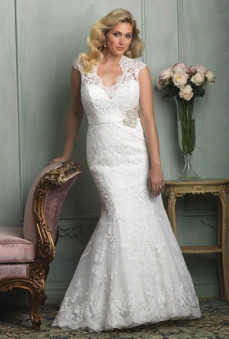 Brides.com: Designer Plus-Size Wedding Dresses We Love. Style W330, lace and tulle wedding dress, price upon request, Allure Bridals