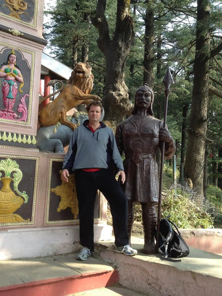 http://taojourneys.com/journey-to-india  Standing beside a Hunuman statue. Huniman is one of the Hindu Gods also known as the monkey God worshipped in India.