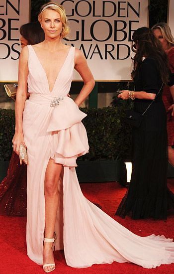 Charlize Theron in Dior on the red carpet at the 2012 Golden Globe Awards in Beverly Hills, California. January 15, 2012.