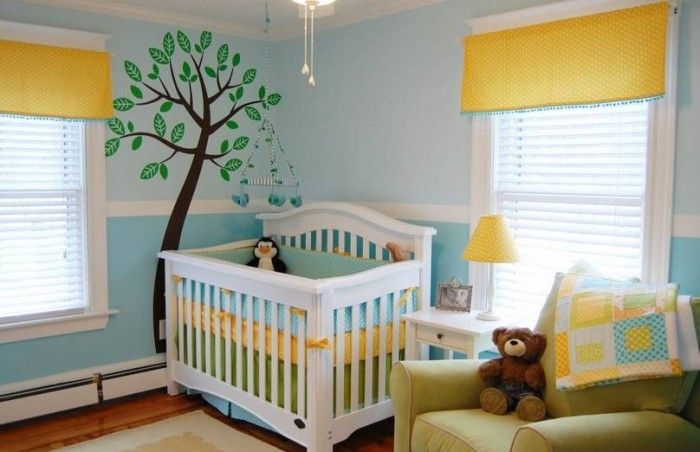 Baby Nursery, Trendy White Wooden Stained Baby Crib Yellow Shades White Blinds Yellow Table Lamp Blue Baby Crib Toy Brown Teddy Bear Tree Wallpaper Green Fabric Arm Chair Chandelier Yellow Blue White Quilts Table Frame: Baby Nursery for Your New Child