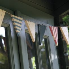 Wooden bunting for outside the cottage. http://smallhousediy.com/category/building-a-playhouse/