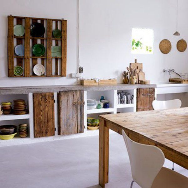 German designer Katrin Arensblends old pallets and ancient wood with stone and white paint