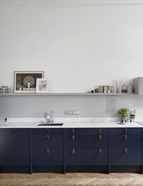 Adore the midnight blue custom cabinets, and simplicity of this kitchen design