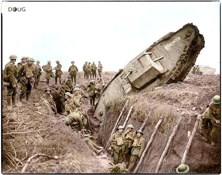 A Mark IV (Male) tank H45 'Hyacinth' of H Battalion ditched in a German trench while supporting the 1st Battalion, Leicestershire Regiment, one mile west of Ribecourt. Some men of the battalion are resting in the trench, 20 November 1917.
