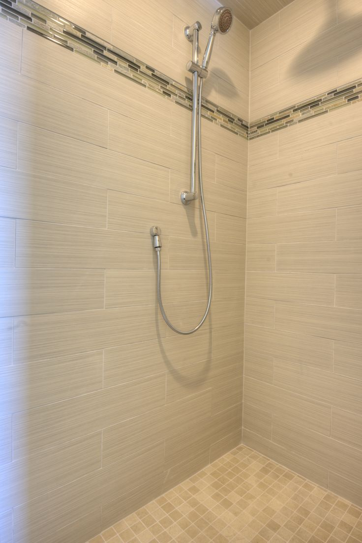 walk in tile shower, no door. Double shower heads, handheld and large  ceiling