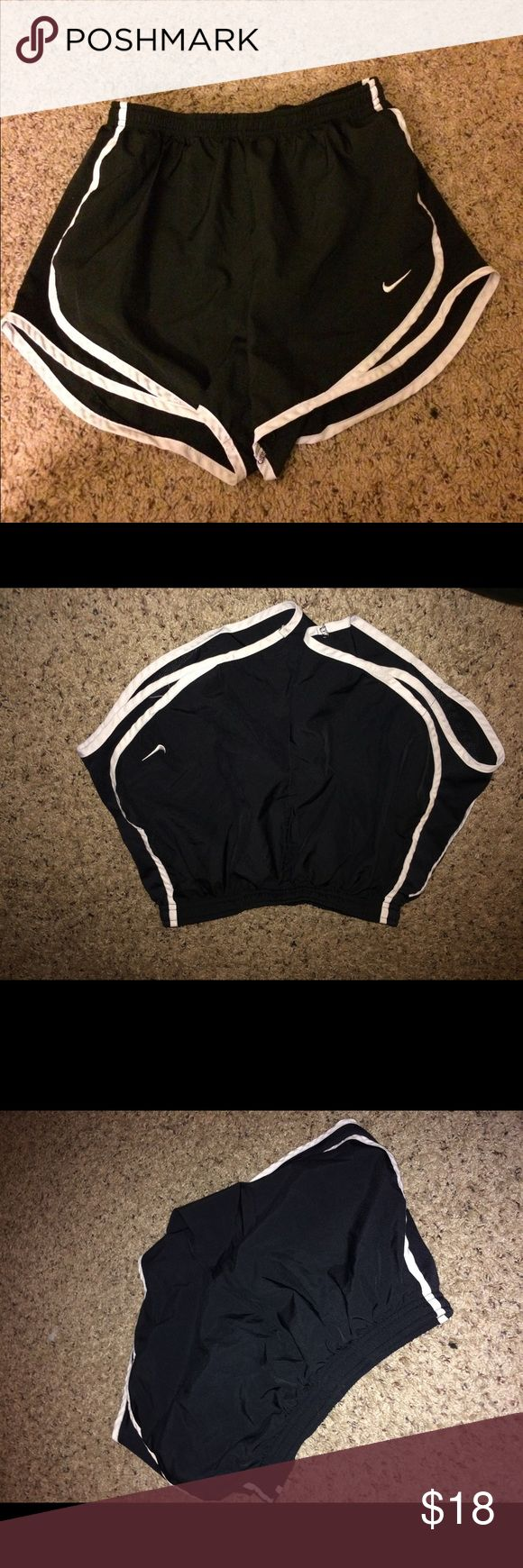 Nike Dri Fit Tempo Shorts Black and white nike Dri fit workout shirts. Two pairs in a small. Like new. No trades Nike Shorts