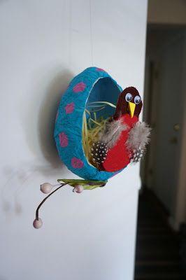 From That Artist Woman blog:  papier mache egg and bird.