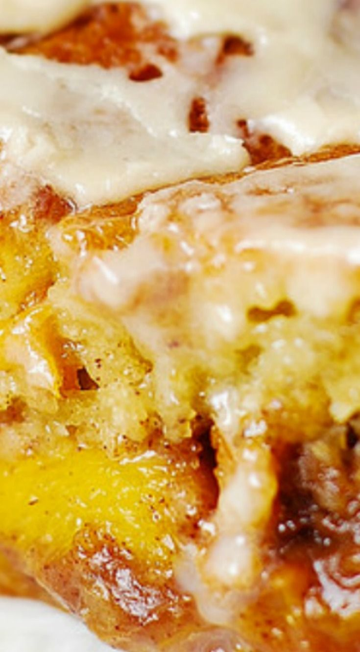 Peach Coffee Cake with Vanilla Glaze ~ Light and fluffy Greek yogurt cake baked with lots of peaches on top (mixed with brown sugar, cinnamon, and nutmeg), and topped with creamy vanilla glaze... One of the best peach coffee cakes you'll ever taste!