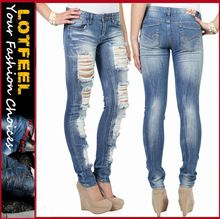 Women skinny jean with full destruction and crinkles in medium blast wash (LOTX325) Best Seller