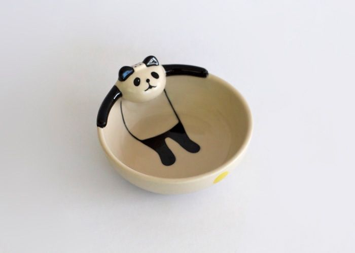 """Here's a lovely hand-painted ceramic bowl featuring a panda relaxing in a """"bath"""". It can be bought from Project Sticky.  Found via HolyCool."""