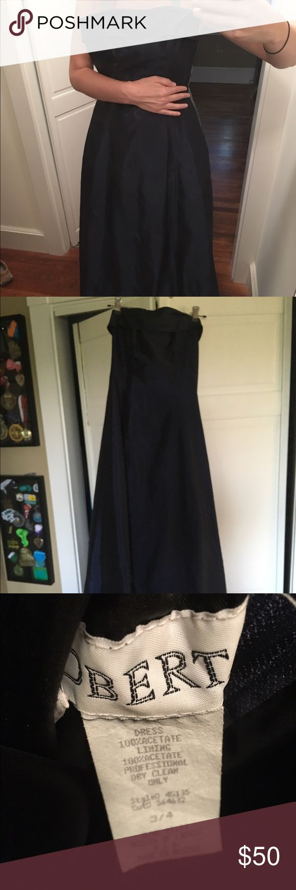 Navy strapless gown This great navy blue prom dress has been in storage and in great condition! Toile under the skirt gives a little poof with a fitted bodice. Strapless. Floor length. A few spots of minor discoloring on top from being stored with a metal hangar clipped on but barely noticeable (see pic). Size 3/4 juniors. Would fit size 0-2 adult woman likely. Shiny material, see tag pic for specifics. Bought at Macy's years ago for $120. Comes with matching shawl/shoulder wrap! Best…